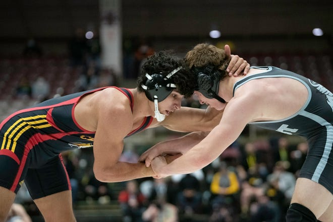 Pueblo West's Hayden Crosson, right, grapples with Coronado's Mitchell Nowlan during their Class 4A 170-pound championship match at the Southwest Motors Events Center on Saturday March 13, 2021.