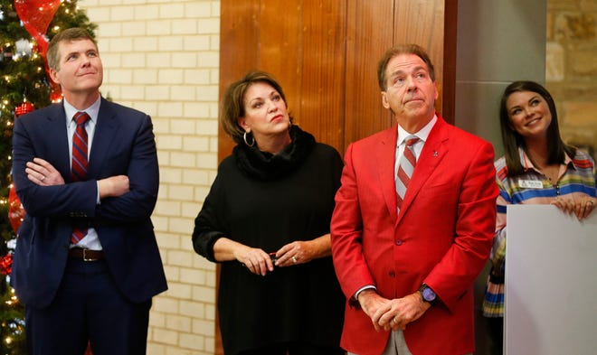 Mayor Walt Maddox, left, Ms. Terry Saban and her husband, University of Alabama head football coach Nick Saban will be part of a parade to celebrate the renaming of 28th Avenue to Nick's Kids Avenue on Aug. 5.