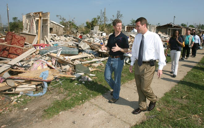 Tuscaloosa Mayor Walt Maddox, seen here touring a devastated Rosedale Court with then-U.S. Department of Housing and Urban Development Secretary Shaun Donovan in the wake of the  April 27, 2011, tornado, will be one of three speakers at a commemorative ceremony at the now-rebuilt Rosedale on Tuesday, the 10th anniversary of the storm that led to the deaths of 53 people -- nine in this housing community alone. [Staff File Photo/Robert Sutton]
