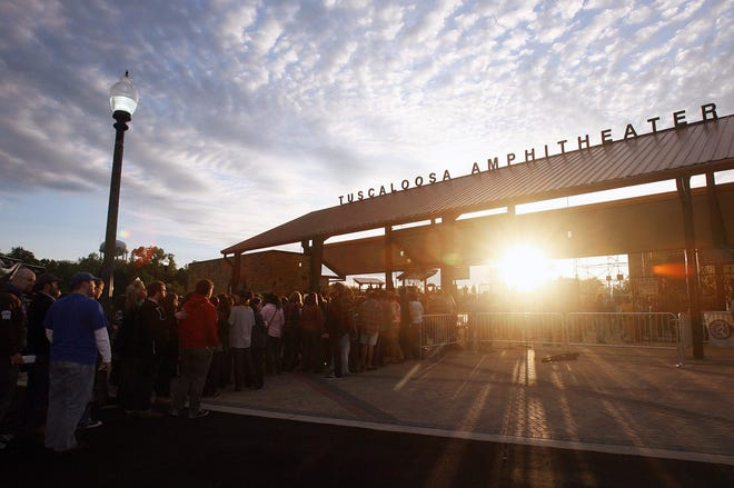 Patrons wait in line at the front gate to enter the newly opened Tuscaloosa Amphitheater during the first night of performances Friday, April 1, 2011. [Staff file photo]