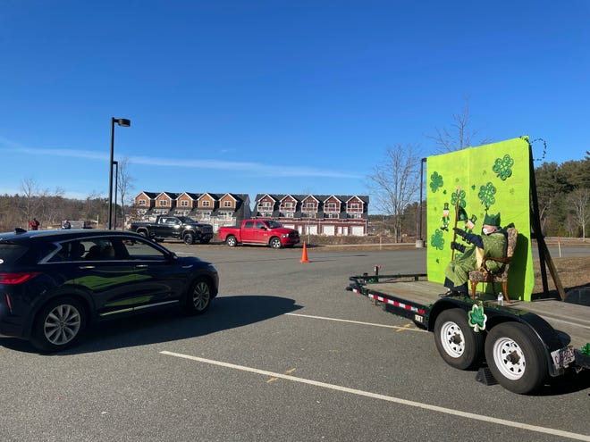 St. Patrick doled out blessings to each car as they departed the Boys and Girls Club.