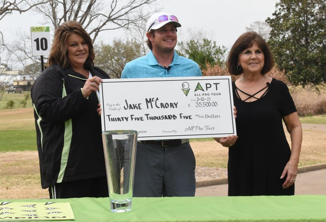 Jake McCrory (center) of Houston won the All-Pro Tournament held Saturday at Oak Wing Golf Club after shooting 23 under par for a total of 265 strokes winning a $35,500 purse. With him are Jessica Viator (left), executive director of the Manna House and Theresa Slater, local APT-WAPT tour chair.