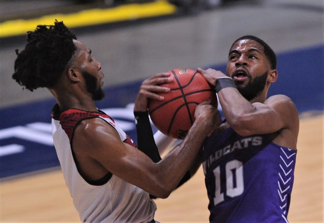 ACU's Reggie Miller, right, battles a Nicholls player for the ball. The Wildcats beat Nicholls 79-45 in the Southland Conference tournament championship game Saturday at the Merrell Center in Katy. ACU plays Texas to open the NCAA Tournament.