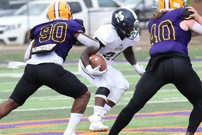Howard Payne running back Billy Reagins makes a cut with the ball during a run in Saturday's game against Hardin-Simmons at Shelton Stadium on March 13, 2021. The Cowboys improved to 3-0 with the 41-14 win.