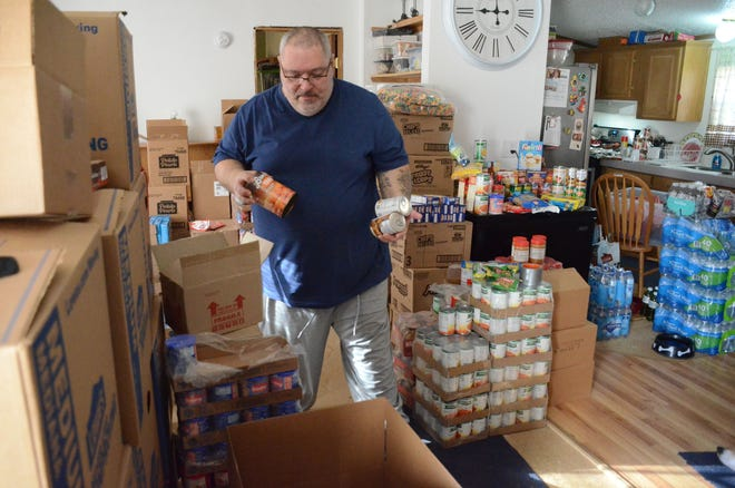 Alphonse Bifulco prepares a box of food  on Saturday for Easter. He is searching for donations for his annual New Leaf program.  (Trace Christenson/The Enquirer