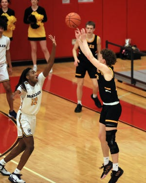 Centerville's Tom House hits this three-pointer for the game-winning shot over Moeller guard Evan Mahaffey in the Division I regional finals game between Moeller and Centerville high schools at Princeton High School on March 13, 2021. House committed to FSU on Wednesday.