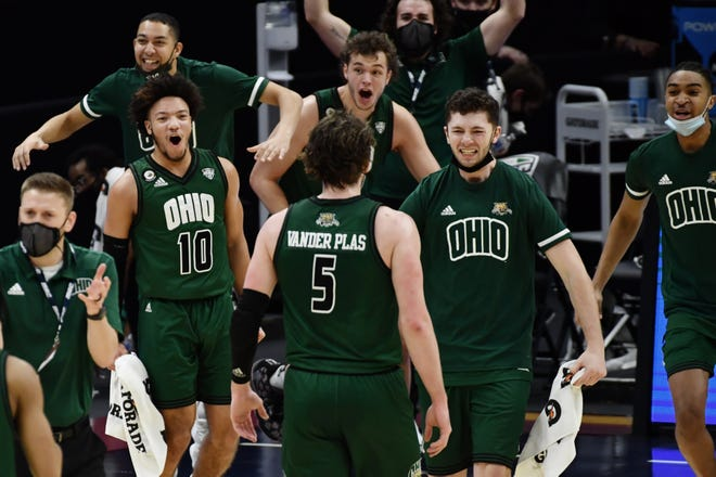 The Ohio Bobcats bench celebrates after a basket by forward Ben Vander Plas (5) during the first half against the Buffalo Bulls at Rocket Mortgage FieldHouse in Cleveland on March 13.