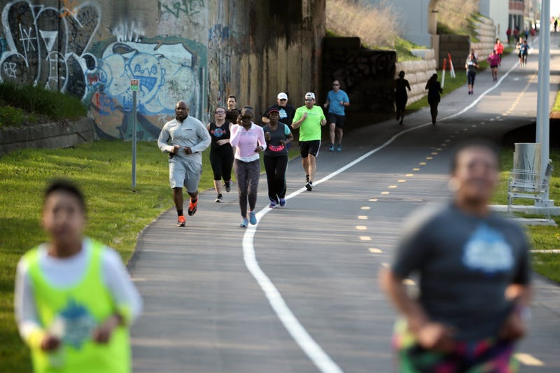 Downtown Runners and Walkers Detroit group members run through the Dequindre Cut on May 3, 2016, in Detroit.