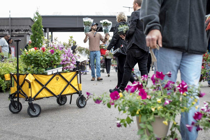 Shoppers fill the market during Flower Day at Detroit Eastern Market in Detroit on May 20, 2018.