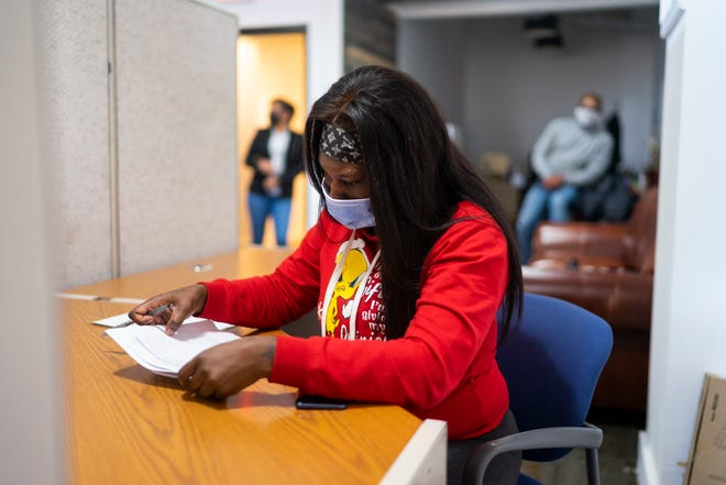 """Kiara Carroll applies for a production assistant position with the help of Kapstone Employment Services on Jan. 27, 2021, in Detroit. The  agency has been working to diversify the automotive engineering and energy industries by placing Detroiters with companies. """"They were encouraging and very detailed when explaining the position,"""" Carroll said."""
