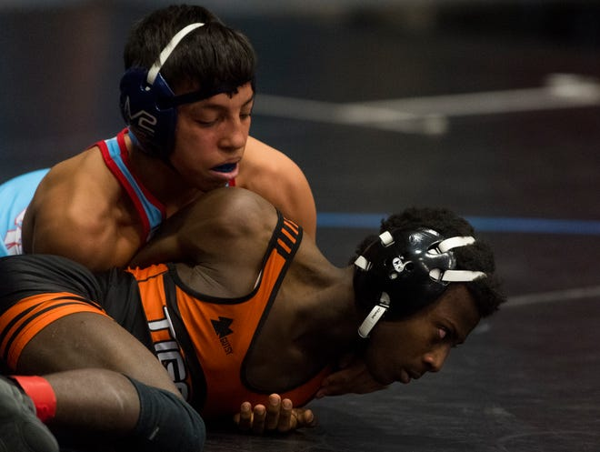 Jordyn Raney of Union County wrestles Trushaun Matt of Hopkinsville during their 106-pound semifinals match of the KHSAA Region 1 wrestling tournament at Union County High School Saturday, March 13, 2021.