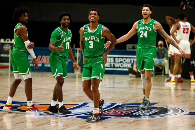 Mar 13, 2021; Frisco, TX, USA; North Texas Mean Green guard Javion Hamlet (3) reacts after a play during the second half against the Western Kentucky Hilltoppers at Ford Center at The Star.