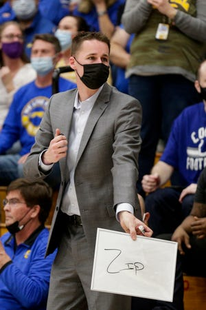 Carmel assistant coach Jacob VanArsdel motions during an IHSAA boys basketball regional championship game, Saturday, March 13, 2021 in Logansport.