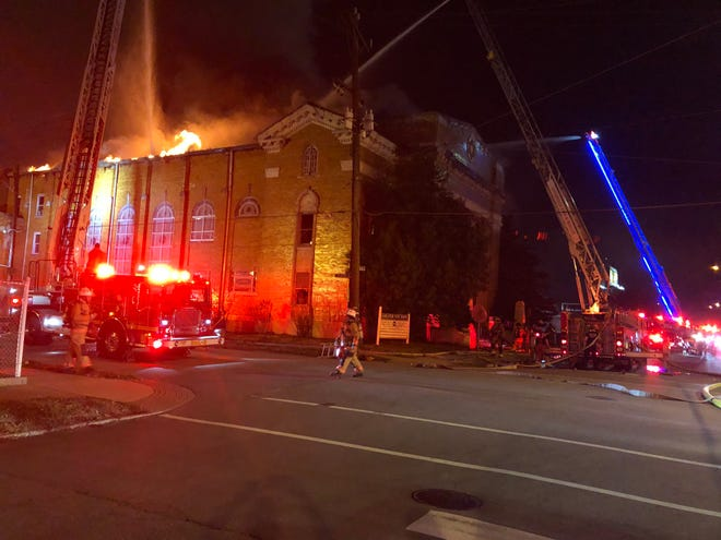 Firefighters work a fire downtown at South Floyd and East Jacob streets.