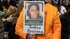 A sign for Breonna Taylor is held during a protest in Louisville Saturday on the anniversary of Breonna Taylor being killed in her apartment by LMPD officers. March 13, 2021