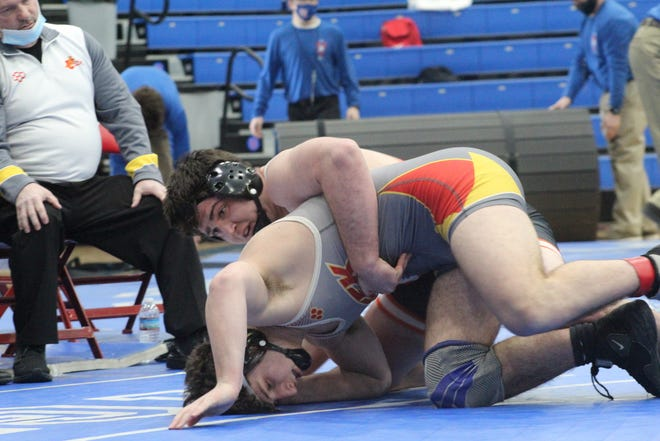 Ashland's Jakob Beverly works to turn Indian Creek's Elijah Llewellyn during their 220-pound third-place match Sunday at the Div. II state wrestling tournament. Beverly won via pin.