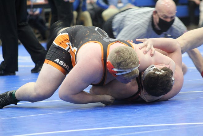 Ashland's Jake Bever holds down Sheridan's Logan Morris during their heavyweight match Sunday at the Div. II state wrestling tournament. Bever won by a 4-1 decision.