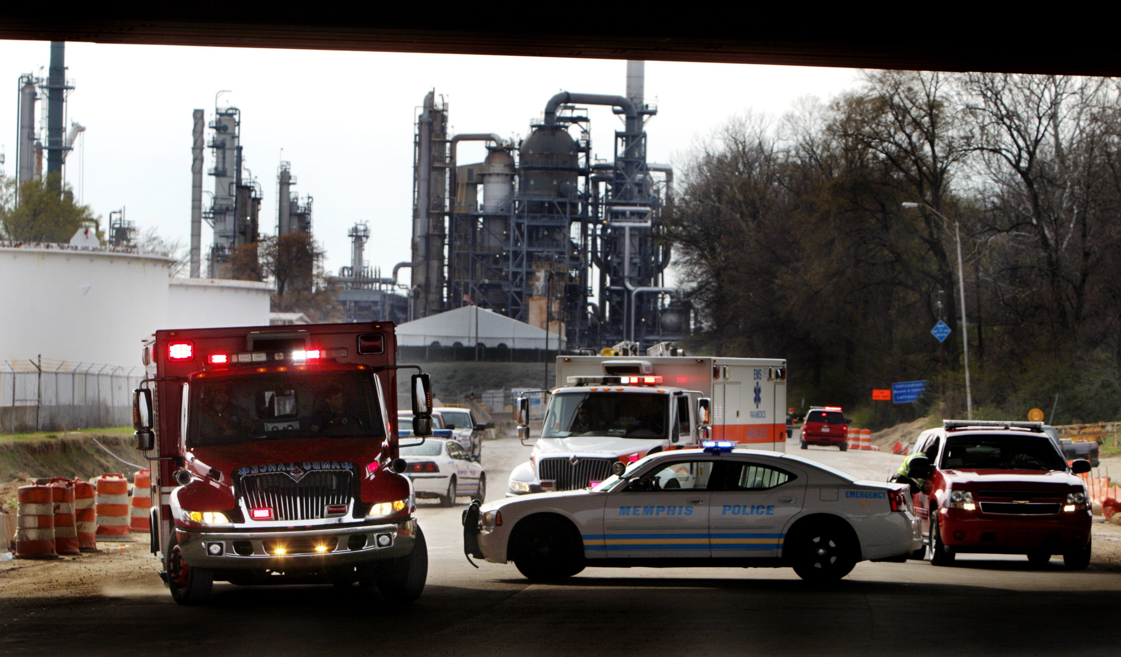 March 6, 2012 -  A pair of ambulances pull out of the Valero oil refinery on Mallory following an explosion at the plant that critically injured three people. Vapors at the plant ignited, seriously burning three men, MFD officials said.