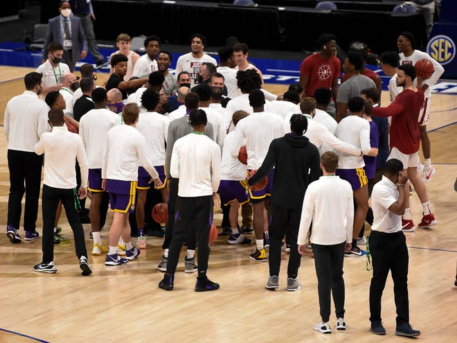 Alabama players and LSU players exchange words as they warm up before  the SEC Men's Basketball Tournament Championship game at  Bridgestone Arena Sunday, March 14, 2021 in Nashville, Tenn.