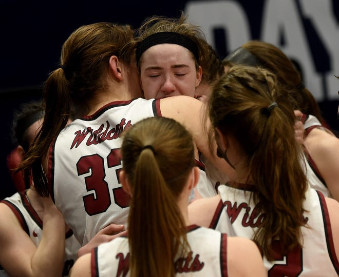 Newark senior Abby Derwacter comforts junior teammate Maddie Vejsicky after losing in double overtime to Cincinnati Mount Notre Dame in the Division I state final on Saturday. Newark finished the season 27-2.