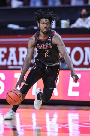 NMSU's Donnie Tillman (2) dricves down court as the New Mexico State Aggies face the Grand Canyon Lopes at The Orleans Arena in the championships of the WAC Tournament in Las Vegas on Saturday, March 13, 2021.