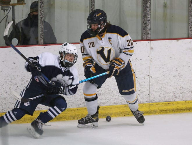Victor's Andrew Haugh (20) is our hockey Player of the Year for 2021.