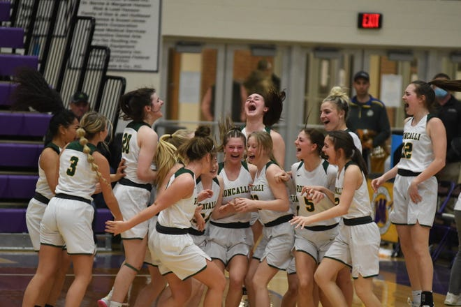 Aberdeen Roncalli celebrates after winning the Class A state championship on Sat., March 13 in Watertown.