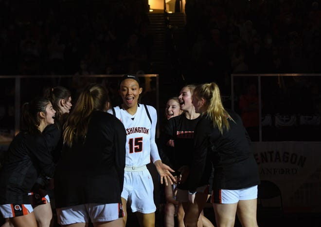 Washington teammates high-five Ndjakalenga Mwenentanda during player introductions before the Class AA girls state tournament championship game on Saturday, March 13, 2021, at the Sanford Pentagon in Sioux Falls.