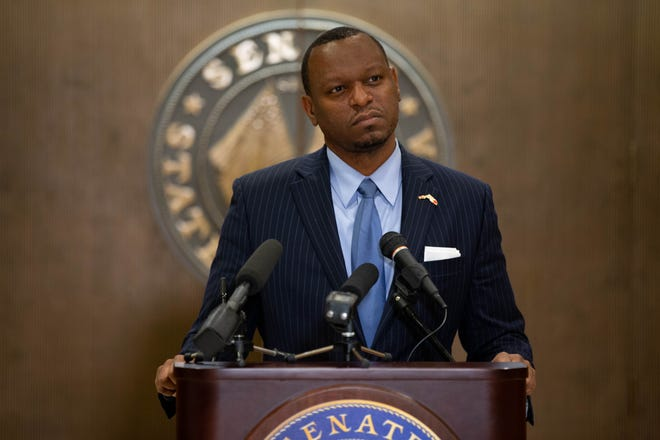 Sen. Randolph Bracy holds a press conference in front of the Senate Chamber doors Tuesday, March 9, 2021.