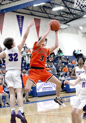 Meadowbrook junior Jake Singleton (3) gets off a running shot during Saturday's Division II regional championship game against Columbus Desales on Saturday at Southeastern High School. Singleton was named Division II Player of the Year in the All-Eastern District basketball honors for this season.