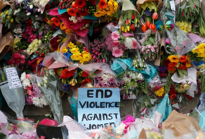 Floral tributes are placed at the bandstand in Clapham Common in London, Sunday, March 14, 2021 in memory of Sarah Everard who was abducted and murdered after last being seen walking home from a friend's apartment in south London on the night of March 3.