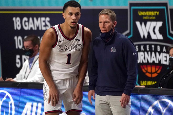 Jalen Suggs, left, Mark Few and Gonzaga are back where they likely would have been last year as a top seed in the NCAA Tournament.
