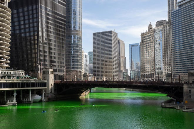 The Chicago River was dyed green ahead of St. Patrick's Day,  Saturday, March 13, 2021 in Chicago. Mayor Lori Lightfoot reversed an earlier decision not to tint the waterway for second year because of the coronavirus pandemic.  (Pat Nabong /Chicago Sun-Times via AP)