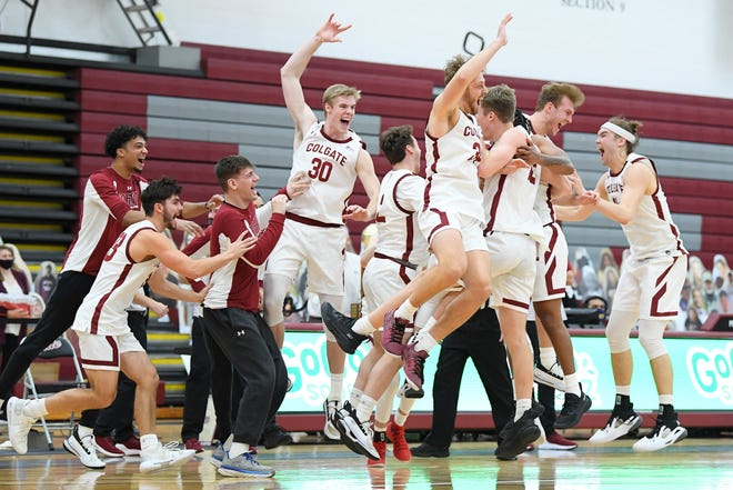 Colgate Raiders players celebrate on the court after defeating the Loyola (Maryland) Greyhounds in the Patriot League Conference Championship game.