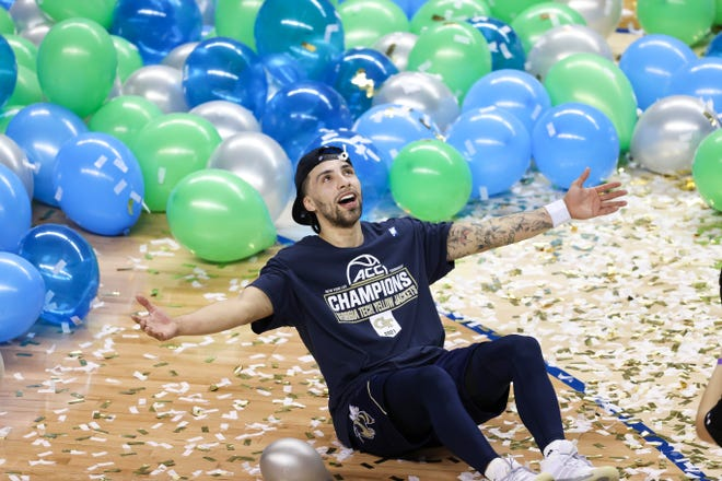 Yellow Jackets guard Jose Alvarado celebrates after Georgia Tech defeated Florida State 80-75 to win its first ACC tournament title since 1993.