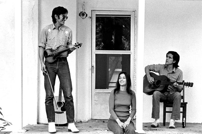 "Songwriters Guy and Susanna Clark on the porch of their house in Nashville in 1972 with their close friend Townes Van Zandt (standing). All three musicians are key figures in the documentary film ""Without Getting Killed or Caught."""