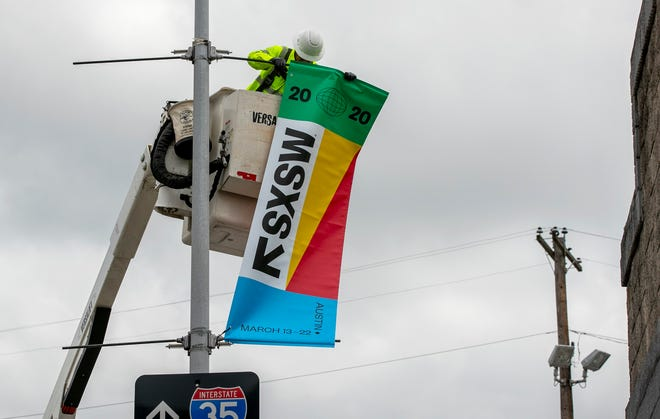 City workers removed banners for SXSW last year when the festival was canceled because of coronavirus fears just days before it was scheduled to take place. The event will be held in an online-only format this year, but organizers say they're optimistic it can return in-person in 2022.