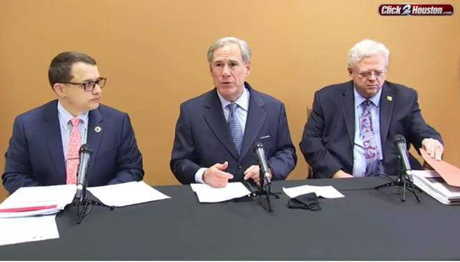 Gov. Greg Abbott, center, on Friday said extreme fire danger has been forecast through the weekend in West Texas.