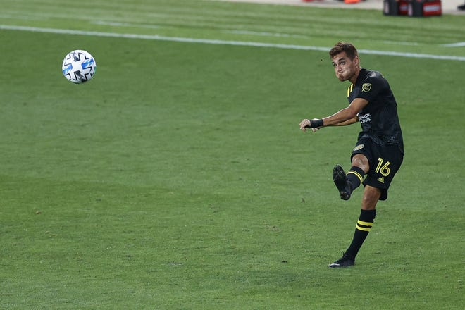 Former Columbus Crew midfielder Hector Jiménezplays a cross against New York City FC during a 2020 match. Jiménezwas signed by Austin FC in December and can play multiple positions along the back line.