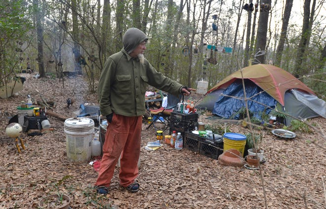 A homeless man who did not wish to be identified shows his camp during a census of Athens-Clarke County's homeless population in January 2015. (File photo)