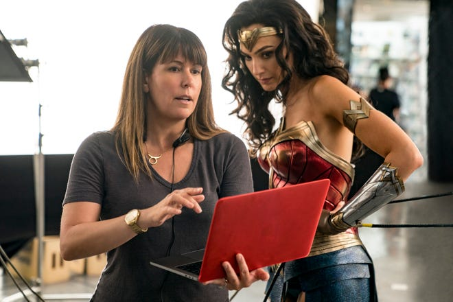 "This image released by Warner Bros. Entertainment shows director Patty Jenkins, left, with actress Gal Gadot on the set of ""Wonder Woman 1984."" (Clay Enos/Warner Bros. Entertainment via AP)"