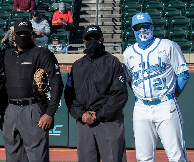 Randy Watkins, second from right, is a Cedar Shoals graduate who was a member of the first all-Black umpiring crew for a Power Five game. (Photo courtesy UNC Athletic Communications)