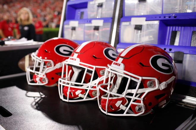 UGA  football helmets (Photo/Joshua L. Jones, Athens Banner-Herald)