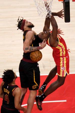 Cavaliers center JaVale McGee (6) fouls Atlanta Hawks forward Nathan Knight (1) during the Hawks' 100-82 win Sunday night in Atlanata. [Ben Gray/Associated Press]