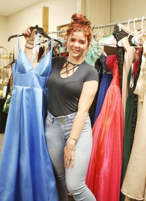 Banquete High School student, Jaden Gillmouth, searches for a prom dress.