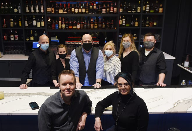 Bill and Jen Malone, owners of the new Noir Bar pose with their new employees at the bar Sunday, March 14, 2021, in Ames, Iowa.