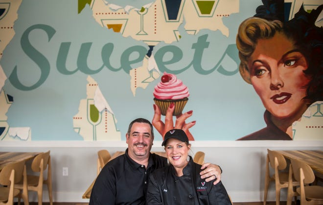 Troy and Amy Adamo pose for a photo at their new business, Vance's Bakery Bar, on James Brown Boulevard in downtown Augusta, Ga., Monday afternoon March 15, 2020. The mural behind them was painted by Steve Snyder.