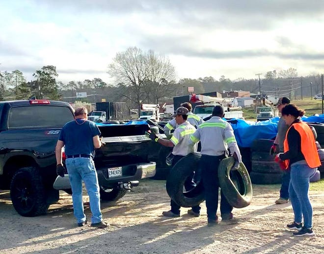 Volunteers assisted in tire pick up