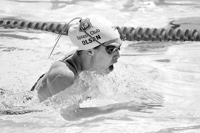 Greta Olsen powers through the water during her prep days at Bartlesville High School.