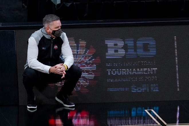 Ohio State head coach Chris Holtmann watches from the bench as his team played Minnesota in the first half of an NCAA college basketball game at the Big Ten Conference tournament in Indianapolis, Thursday, March 11, 2021. (AP Photo/Michael Conroy)